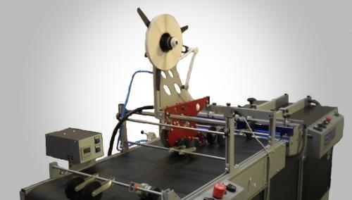 Tape application system air vacuum feeder belt conveyor tear strip